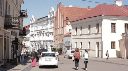 vilnius old town : Vilnius, Lithuania. People Walking Through Gate Of Dawn In Sunny Spring Day. Famous Religious, Historical And Cultural Monument, Chapel With Miraculous Image Of Our Lady Of Mercy