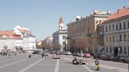 vilnius old town : Vilnius, Lithuania. People Walking In Town Hall Square In Sunny Spring Day. Famous Street In Old Town. UNESCO World Heritage Site Stock Footage