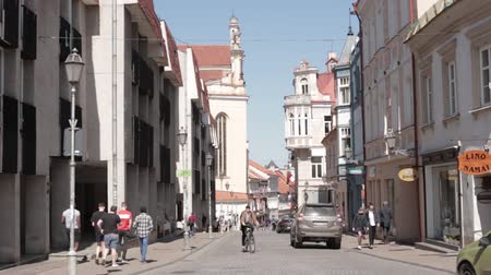 vilnius old town : Vilnius, Lithuania. People Walking In Pilies Street In Sunny Spring Day. Famous Street In Old Town. UNESCO World Heritage Site