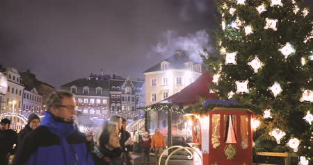 latvia : Riga, Latvia - December 18, 2017: People Walking In Traditional Christmas Market On Dome Square. Trading Houses In Winter Evening Stock Footage