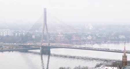 latvia : Riga, Latvia. Top View Of Cityscape. Vansu Bridge And Riga Dome Cathedral In Misty Fog Rainy Winter Day Stock Footage