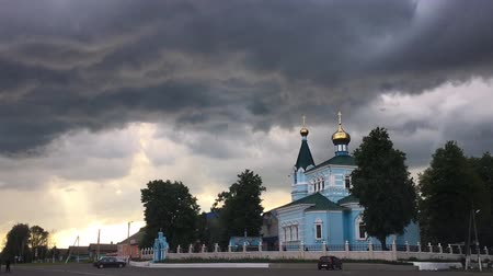 john : Time-lapse, Timelapse, St. John The Korma Convent Church In Korma Village, Dobrush District, Belarus. Famous Orthodox Church Against Background Of An Approaching Storm