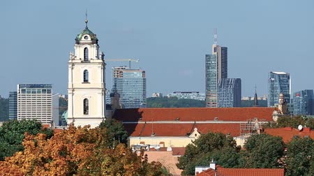 vilnius old town : Vilnius, Lithuania. View Of Catholic Church Of St. Johns With Bell Tower On Background Modern Buildings Stock Footage
