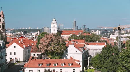 Литва : Vilnius, Lithuania. Top View Of Catholic Church Of St. Johns With Bell Tower And St. Nicholas Church In Sunny Day. Pan, Panorama Стоковые видеозаписи