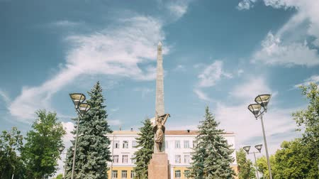stella : Gomel, Belarus. Monument To Heroes-members Of The Komsomol At Crossroads Of Streets Of Karpovicha And Zharkovskogo In Sunny Winter Day, Hyperlapse