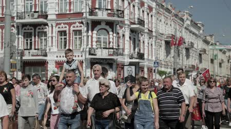 wwii : Gomel, Belarus - May 9, 2018: Ceremonial Procession Of Parade. Immortal Regiment Action March At Parade Procession Of People With Portreits Of WW2 Heroes. Annual Victory Day Celebration 9 May Stock Footage