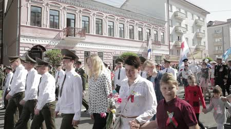 participants : Gomel, Belarus - May 9, 2018: Ceremonial Procession Of Parade. Military And Civilian People On The Festive Decorated Street. Celebration Victory Day 9 May In Gomel Homiel Belarus