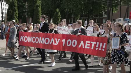 procession : Gomel, Belarus - May 9, 2018: Ceremonial Procession Of Parade. Immortal Regiment Action March At Parade Procession Of People With Portreits Of WW2 Heroes. Annual Victory Day Celebration 9 May Stock Footage