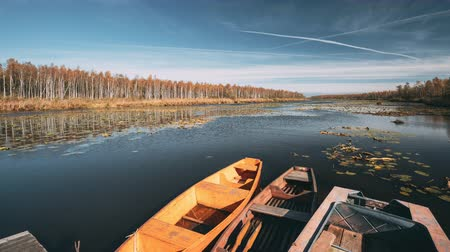 rowboat : Lake Or River And Old Rowing Fishing Boats In Beautiful Autumn Sunny Day Stock Footage