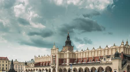 Krakow, Poland. Main Market Square In Cloudy Summer Day. Famous Landmark. Unesco World Heritage Site