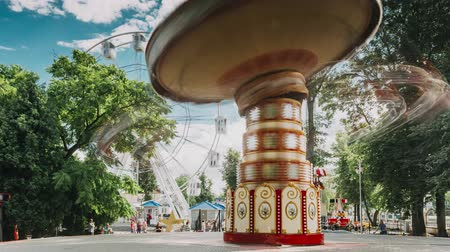 Rotating High Speed Carousel Merry-Go-Round In City Amusement Park