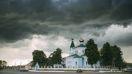 ortodoks : St. John The Korma Convent Church In Korma Village, Dobrush District, Belarus. Famous Orthodox Church Against Background Of An Approaching Storm. Time-lapse, Timelapse, Stok Video