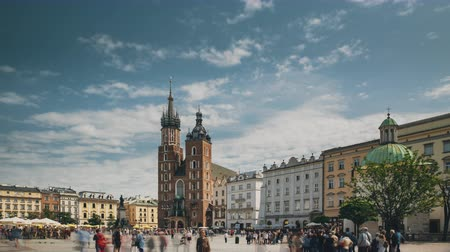 marys : Krakow, Poland. St. Marys Basilica And Cloth Hall Building. Famous Old Landmark Church Of Our Lady Assumed Into Heaven. Saint Marys Church In Of Main Market Square. UNESCO World Heritage Site