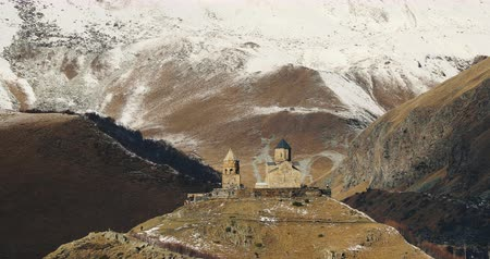 worship : Stepantsminda, Gergeti, Georgia. Famous Gergeti Trinity Tsminda Sameba Church In Late Autumn Landscape Stock Footage