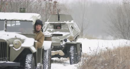 ba : Gomel, Belarus - November 25, 2018: Re-enactors Dressed As Russian Soldiers Of WWII drives Soviet WWII Army Truck GAZ-67 Car And Armored Scout Car BA-64 In Winter Forest. WWII Equipment Of Red Army