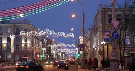 Gomel, Belarus - December 17, 2018: Traffic On Sovetskaya Street During Winter Christmas New Year Holidays. Street Decorating In Festive Lights Lighting