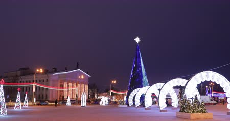 new town : Gomel, Belarus. Gomel Regional Drama Theatre And Main Christmas Tree With Festive Illumination On Lenin Square. New Year, Winter Holidays In Belarus Stock Footage