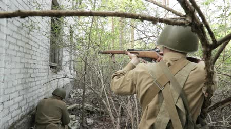 mopping : Gomel, Belarus - April 30, 2018: Russian Soldiers Of World War II Performing Mopping-up Operation. Red Army Infantry Cover Each Other During House Assault. Men Attacking During Historical Reenactment