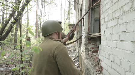 Gomel, Belarus - April 30, 2018: Russian Soldiers Of World War II Performing Mopping-up Operation. Red Army Infantry Cover Each Other During House Assault. Men Attacking During Historical Reenactment
