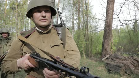 sovyet : Gomel, Belarus - April 30, 2018: Re-enactor Dressed As Russian Soviet Infantry Red Army Soldier Of World War II Walking With Weapon In Spring Forest