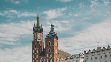marys : Krakow, Poland. St. Marys Basilica And Cloth Hall Building. Famous Old Landmark Church Of Our Lady Assumed Into Heaven. Saint Marys Church In Of The Main Market Square. UNESCO World Heritage Site