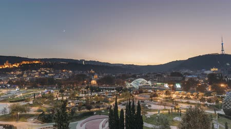 kaukázus : Tbilisi, Georgia. Modern Urban Night Cityscape. Evening Night Scenic View Of City Center In Night Lighting. Time Lapse Day To Night Transition