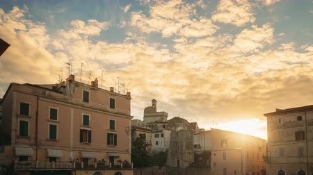 итальянский : Terracina, Italy. Piazza Municipio And View Of Castle Castello Frangipane In Upper Town In Sunrise Time Стоковые видеозаписи