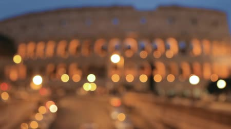 amfiteátr : Rome, Italy. Colosseum. Traffic In Rome Near Famous World Landmark In Evening Time. Abstract Blurred Background. Blur boke bokeh background.