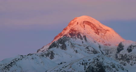 gergeti : Stepantsminda, Gergeti, Georgia. Mount Kazbek Covered Snow In Winter Sunrise. Morning Dawn Colored Top Of Mountain In Pink-orange Colors. Awesome Winter Georgian Nature Landscape