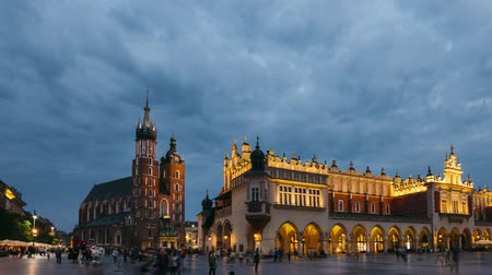 marys : Krakow, Poland. Night View Of St. Marys Basilica And Cloth Hall Building. Famous Old Landmark Church Of Our Lady Assumed Into Heaven. UNESCO World Heritage Site