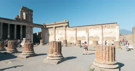 Pompeii, Italy - October 18, 2018: People Tourists Walking Near Remains Of Ancient Building In Sunny Day. UNESCO World Heritage Site