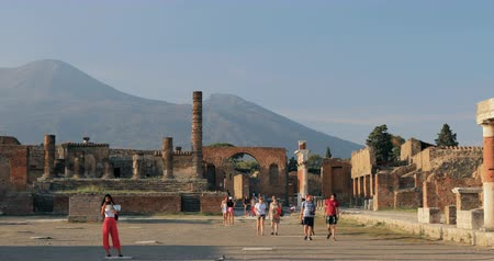 Pompeii, Italy - October 18, 2018: People Walking Near Remains Of Ancient Buildings On Territory Pompeii Forum. UNESCO World Heritage Site