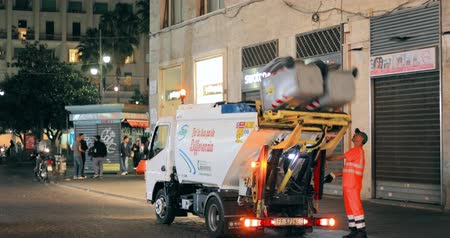 especial : Naples, Italy - October 18, 2018: Automated Garbage Truck Working In Night Street. Dustcart, Trash Truck, Rubbish Truck, Junk Truck, Dumpster Specially Designed To Collect Municipal Waste