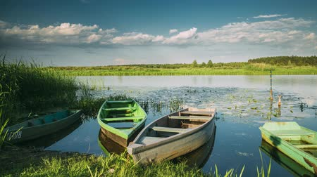 rowboat : Lake Or River And Old Wooden Rowing Fishing Boats In Beautiful Summer Sunny Evening