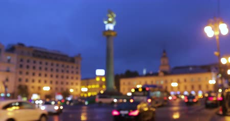 Джордж : Tbilisi, Georgia. Abstract Blurred Bokeh Night Traffic With Many Cars Urban Backdrop. Blurred Colorful Bokeh Background With Defocused Lights Of Liberty Monument Depicting St George And City Hall.