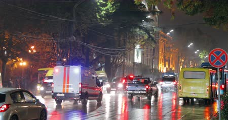 Tbilisi, Georgia - November 22, 2018: Armored Car Of Bank Of Georgia With Active Rooftop Flashing Lights Transporting Valuables. Traffic In Night Shota Rustaveli Avenue Street