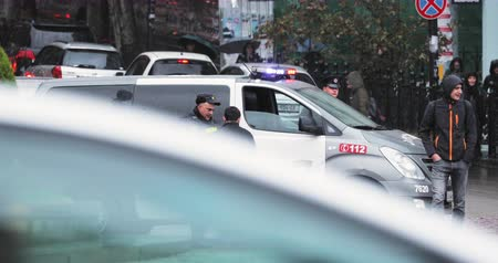 Tbilisi, Georgia - November 22, 2018: Traffic Road Police Officer Policeman Inspector Talking Wigh Driver. Police Car With Active Rooftop Flashing Lights Provide Security Stockvideo