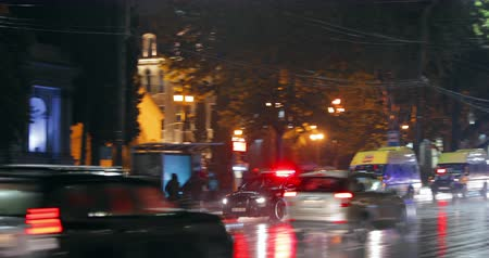 Tbilisi, Georgia - November 22, 2018: Traffic Road Police Car With Active Rooftop Flashing Lights Provide Security. Emergency Lights System Els Activated Driving In Night Shota Rustaveli Avenue Stok Video