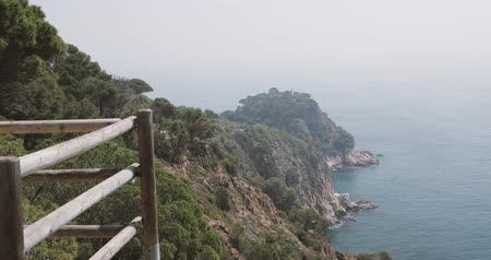 baleár : Tossa De Mar, Girona, Spain. Balearic Sea. Woman Tourist With Backpack Enjoying View Of Spanish Nature With Summer Rocky Landscape And Seascape