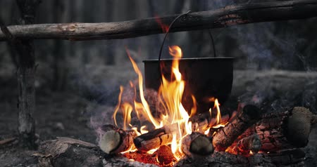 kitchenware : Old Retro Camp Saucepan Boiled Water For Soup Preparation On A Fire In Forest. Flame Fire Bonfire At Summer Evening