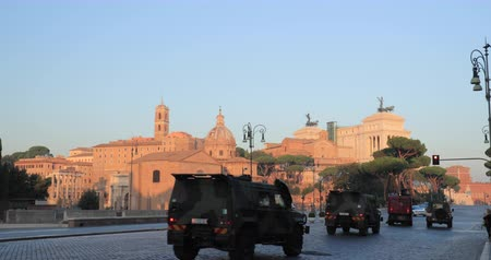 ave : Rome, Italy. Two Military Trucks Driving On Via Dei Fori Imperiali Street In Sunny Summer Morning. Military Vehicles In Historic Centre Of Rome