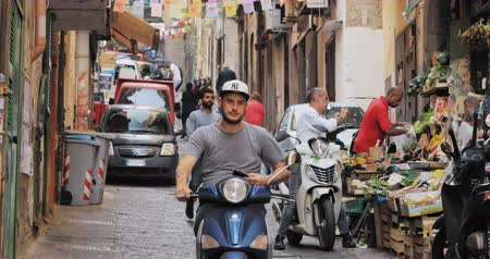 Naples, Italy - October 17, 2018: Traffic With Scooters In Narrow Street. People Riding On Scooters In Summer Day Stockvideo