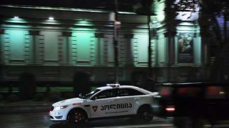 vigile : Tbilisi, Georgia - November 22, 2018: Traffic Road Police Car With Active Rooftop Flashing Lights Provide Security. Emergency Lights System Els Activated Driving In Night Shota Rustaveli Avenue Filmati Stock