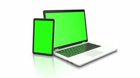 érintőképernyő : Modern laptop and tablet with a green screen. Animation on white background. Chrome key and alpha channel. Stock mozgókép