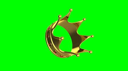 skarb : Looped animation of rotating crown on green background. Wideo