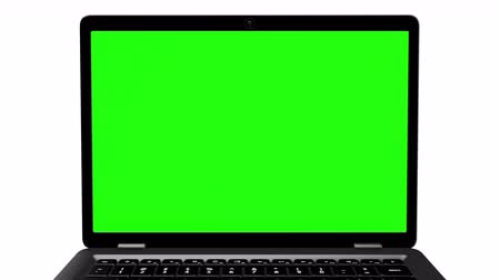 jegyzettömb : Modern black laptop appearing on a white background with a green screen. 4k animation