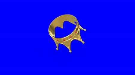 šperk : Golden crown falling on a colored background. Animation with chromakey