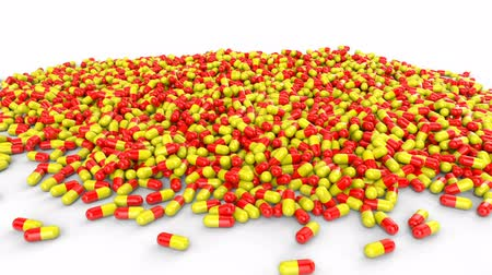 Red-yellow pills capsules on a white background abstract concept. Animation with alpha channel