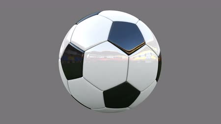 Rotation of a realistic soccer ball on a gray background. animation has alpha channel Stock mozgókép