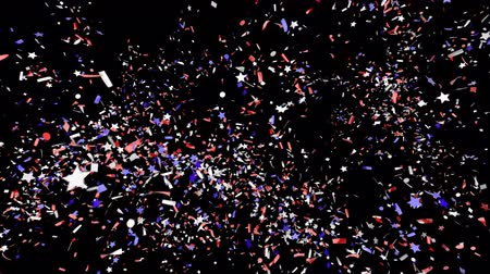 Blue, Red, and White festive confetti explosion falling down on a black and green background.